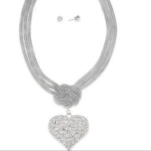 Silver braided necklace with heart pendant